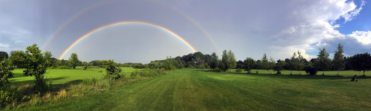 golf course and a double rainbow